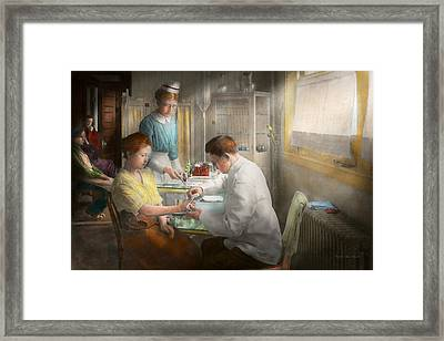 Doctor - Applying First Aid - 1917 Framed Print by Mike Savad