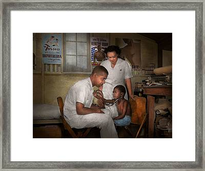 Doctor - Pediatrician - From The Heart 1942 Framed Print by Mike Savad