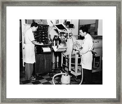 Doctors Are Studying The Mechanism Framed Print by Everett