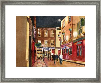 Downtown Saturday Night Framed Print by Marsha Elliott