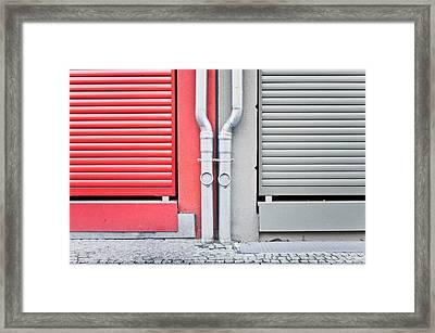 Drain Pipes Framed Print by Tom Gowanlock