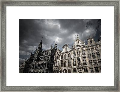 Drama At Grand Place Framed Print by Chris Fletcher