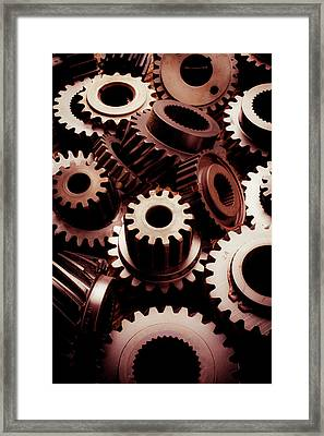Dramatic Light On Gears Framed Print by Garry Gay