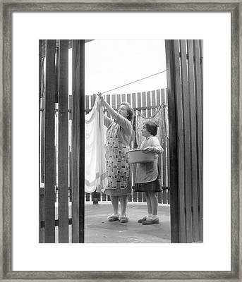 Drying Porch Framed Print by Fred Morley