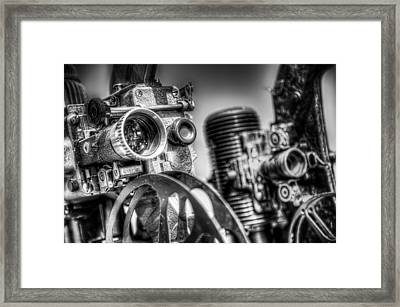 Dueling Projectors Framed Print by Scott Norris