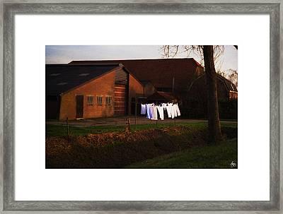 Dutch Washline At Dusk Framed Print by Wayne King