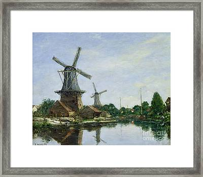 Dutch Windmills Framed Print by Eugene Louis Boudin
