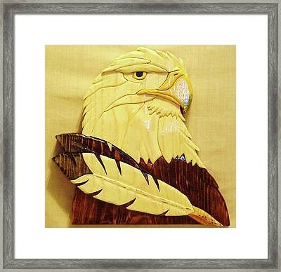 Eaglehead With Two Feathers Framed Print by Russell Ellingsworth