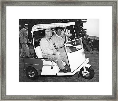 Eisenhower In A Golf Cart Framed Print by Underwood Archives