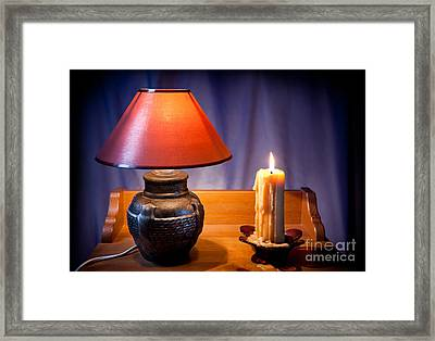 Electrical Night Light Lamp And Burning Candle  Framed Print by Arletta Cwalina
