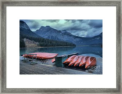 Emerald Lake Canoes Framed Print by Adam Jewell