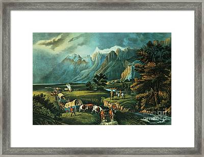 Emigrants Crossing The Plains Framed Print by Currier and Ives