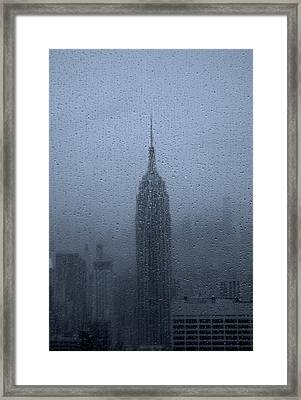 Empire State In The Rain Framed Print by Martin Newman
