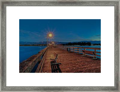 Empty Pier Glow Framed Print by Connie Cooper-Edwards