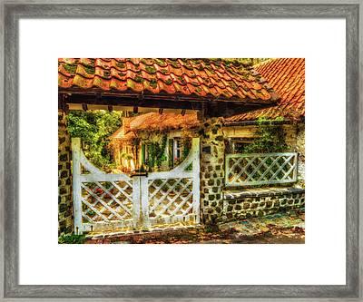 Enchanted Cottage Framed Print by Wim Lanclus