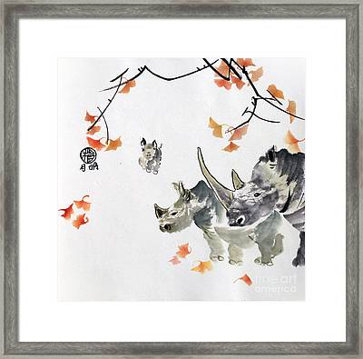 Endangered Rhinos Framed Print by Ming Yeung