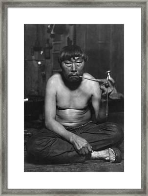 Eskimo Smoking Pipe, Photograph Framed Print by Everett