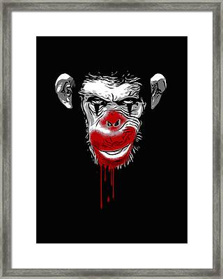 Evil Monkey Clown Framed Print by Nicklas Gustafsson