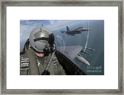 F-16 Fighting Falcons Flying Framed Print by Stocktrek Images