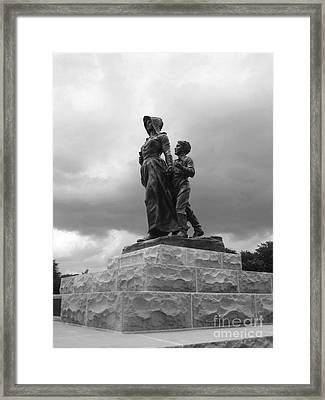 Facing The Storm Pioneer Woman Statue Oklahoma Icon   Framed Print by Ann Powell