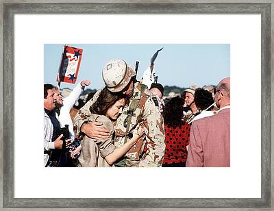 Family And Friends Greet Members Framed Print by Everett