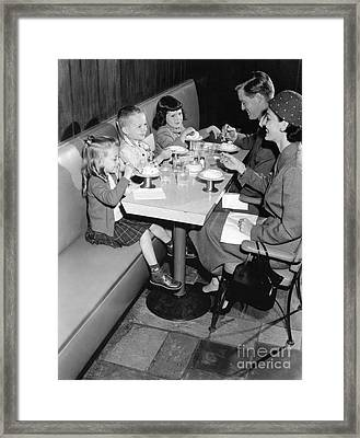 Family Eating Ice Cream At A Diner Framed Print by H. Armstrong Roberts/ClassicStock
