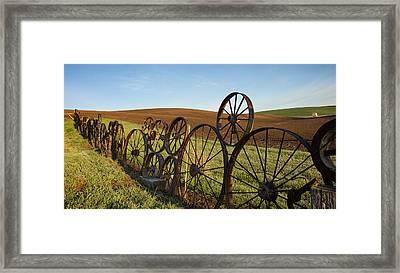 Fence Of Wheels Framed Print by Mary Lee Dereske