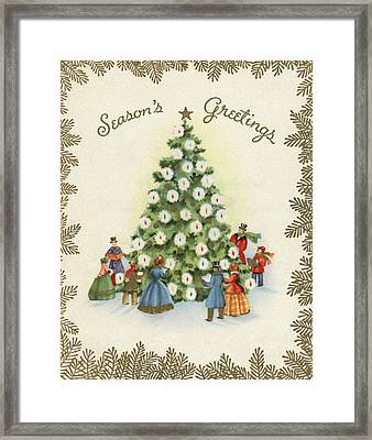 Festive Christmas Tree In A Town Square Framed Print by American School