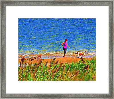 Playing Fetch With Dog Along The Shoreline Framed Print by Le Artman