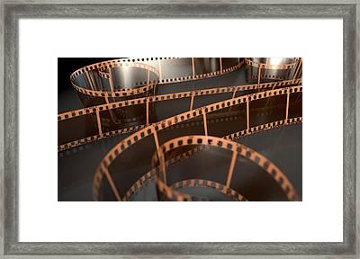 Film Strip Curled Framed Print by Allan Swart