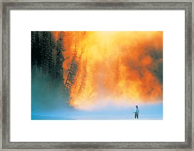 Fire Fly Fishing Framed Print by Darwin Wiggett
