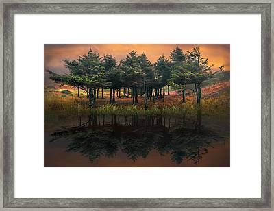 Fire In The Lake Framed Print by Debra and Dave Vanderlaan