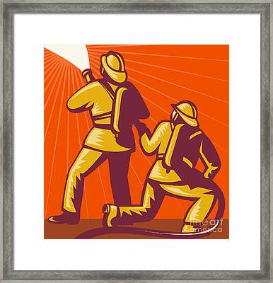 Firemen Aiming A Fire Hose Framed Print by Aloysius Patrimonio