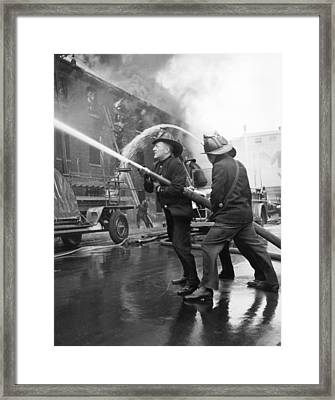 Firemen With Hose Framed Print by Underwood Archives