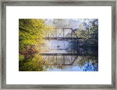 Fishing Under The Trestle Framed Print by Debra and Dave Vanderlaan