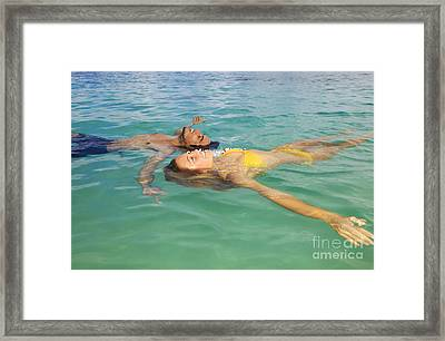 Floating Young Couple Framed Print by Tomas del Amo - Printscapes
