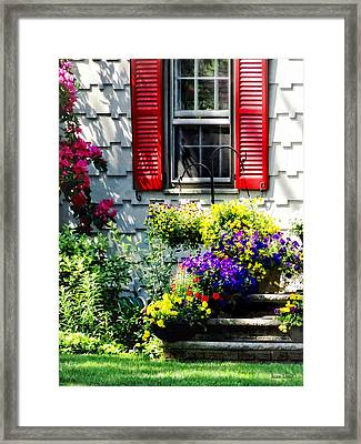 Flowers And Red Shutters Framed Print by Susan Savad