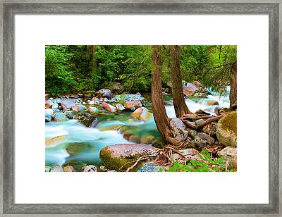 Flowing Into The Solace Framed Print by Jeff Swan