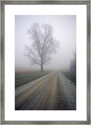 Fog Moves In On A Gravel Country Road Framed Print by Joel Sartore