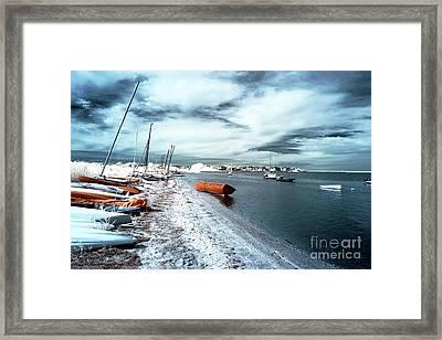 Follow The Orange Boat Framed Print by John Rizzuto