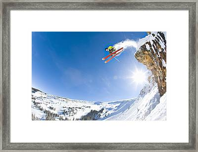 Freestyle Skier Jumping Off Cliff Framed Print by Tyler Stableford