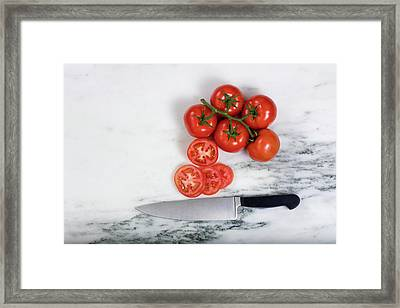 Freshly Sliced Tomatoes On Natural Marble Stone Background  Framed Print by Thomas Baker