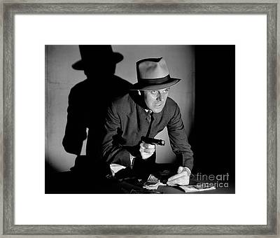 Gangster Stealing Money At Gunpoint Framed Print by H. Armstrong Roberts/ClassicStock