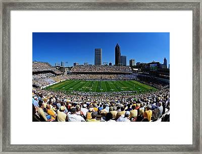 Georgia Tech Bobby Dodd Stadium And Atlanta Skyline  Framed Print by Getty Images
