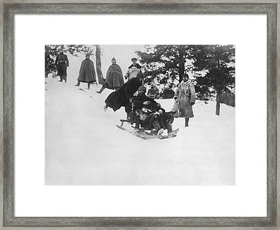 German Soldiers Sledding Framed Print by Underwood Archives