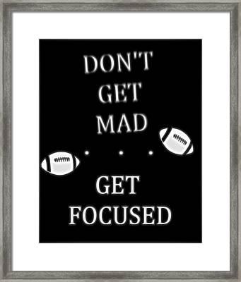 Get Focused Football Framed Print by Dan Sproul