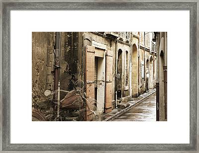 Ghost Harley On Narrow Street Framed Print by Gary Gunderson