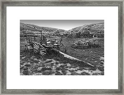 Ghost Wagons Of Bannack Montana Framed Print by Daniel Hagerman