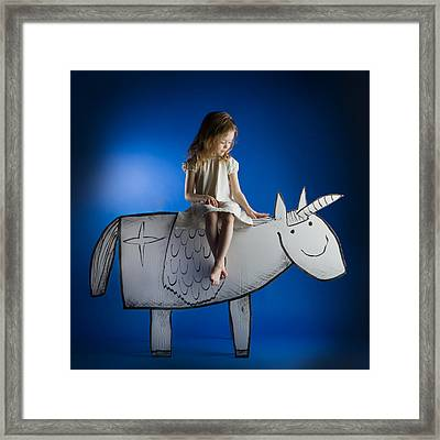 Girl And Her Unicorn Framed Print by Eva Miliuniene