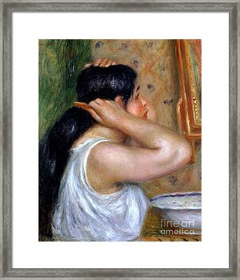 Girl Combing Her Hair Framed Print by Pierre Auguste Renoir